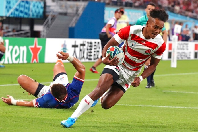 Japan's Kotaro Matsushima runs to score a try during the Rugby World Cup Pool A game at Tokyo Stadium between Russia and Japan in Tokyo, Japan, Friday, Sept. 20, 2019. (AP Photo/Eugene Hoshiko)