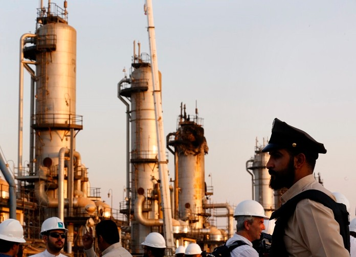 A security guard stands alert in front of Aramco's oil processing facility after the recent Sept. 14 attack on Aramco's oil processing facility in Abqaiq, near Dammam in Saudi Arabia, Friday, Sept. 20, 2019. (AP Photo/Amr Nabil)
