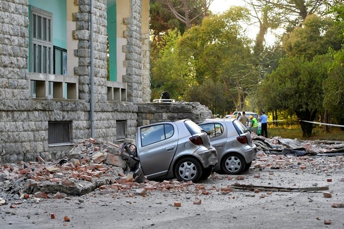 Damaged cars are shown outside the Faculty of Geology building after an earthquake in Tirana, Albania, Saturday, Sept. 21, 2019. (AP Photo/Hektor Pustina)