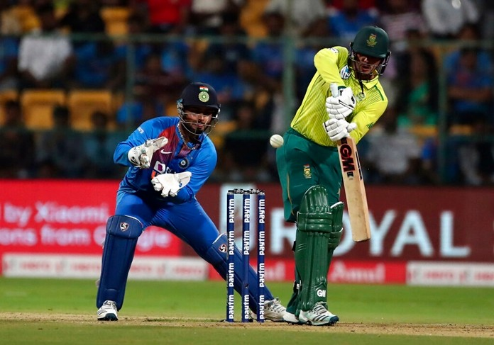 South Africa's captain Quinton de Kock, right, plays a shot during the third and last T20 cricket match between India and South Africa in Bangalore, India, Sunday, Sept. 22, 2019. (AP Photo/Aijaz Rahi)