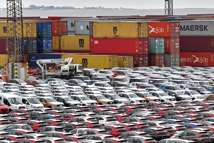 This May 16, 2019, file photo shows cars for import and export in the free harbour in Bremerhaven, Germany. (AP Photo/Martin Meissner)