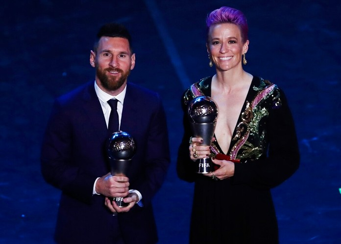 Lionel Messi poses with Megan Rapinoe after they received the Best FIFA Men's, Women's player award during the Best FIFA soccer awards ceremony, in Milan's La Scala theater, northern Italy, Monday, Sept. 23, 2019. (AP Photo/Antonio Calanni)