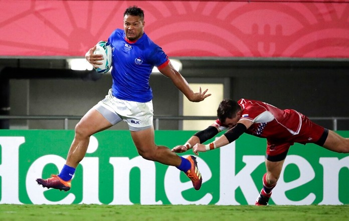Samoa's Alapati Leiua runs past Russia's Vasily Artemyev to score a try during the Rugby World Cup Pool A game between Russia and Samoa at Kumagaya Rugby Stadium, Kumagaya City, Japan, Tuesday, Sept. 24, 2019. Samoa defeated Russia 34-9. (AP Photo/Jae Hong)