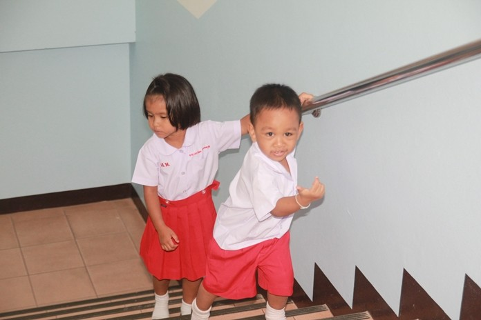 The children are thrilled with their new stainless-steel stairway railing.