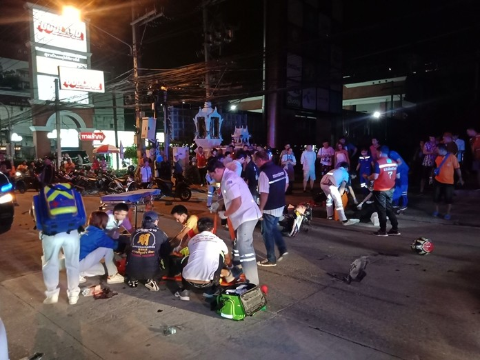 Rescue workers tend to the carnage on Pattaya Center Road.