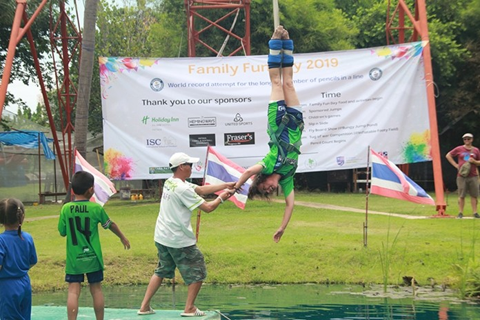 Six sponsored bungy jumps, including one taken by Margie Granger, raised 34,000 baht.