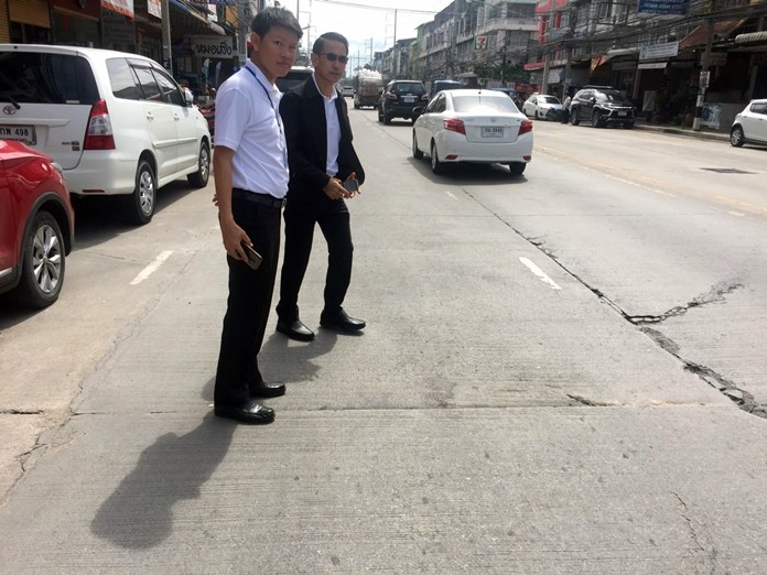 Pattaya Deputy Mayor Pattana Boonsawad leads a team of officials to inspect damaged sections on Thepprasit Road.