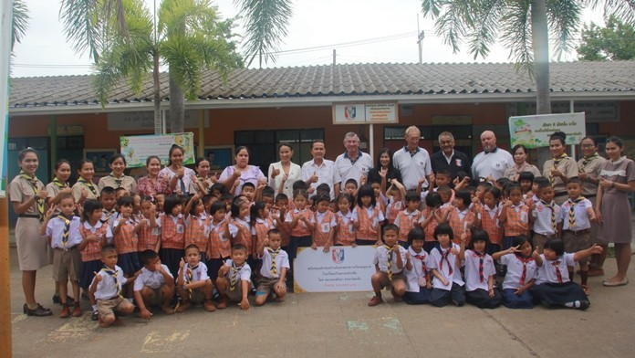 The PSC committee together with the teachers and students pose in front of the kindergarten class which now boats of a brand-new awning to protect them from the rain.