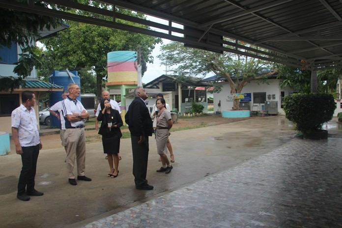 The PSC Committee inspect the newly erected awnings and the tiled pavement.