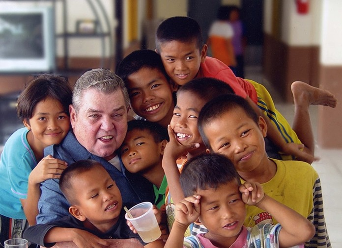 Father Ray with a group of former street kids.