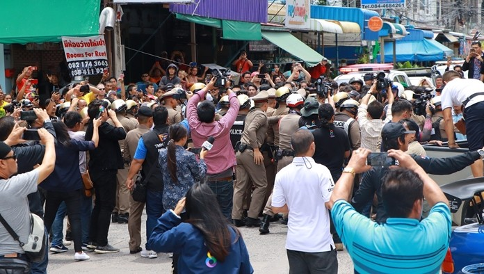 Over 200 police officers fitted with CCTVs on their helmets to record troublemakers were needed to hold back onlookers.