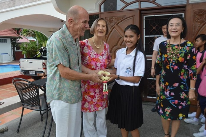 HHNFT Director Radchada Chomjinda (right) brought children and staff from the Human Help Network Thailand to the Deter residence to wish Dr. Margret Deter (2nd left) a very Happy Birthday.