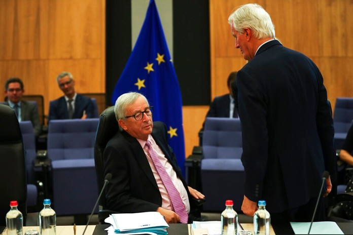 """European Commission President Jean-Claude Juncker, left, talks to European Union chief Brexit negotiator Michel Barnier during a weekly meeting of the College of Commissioners at EU headquarters in Brussels, Wednesday, Oct. 2, 2019. British Prime Minister Boris Johnson was due to send to Brussels what he says is the U.K.'s """"final offer"""" for a Brexit deal, with the date set for Britain's departure less than a month away. (AP Photo/Francisco Seco)"""