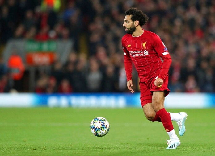 Liverpool's Mohamed Salah controls the ball during the Champions League group E soccer match between Liverpool and Red Bull Salzburg at Anfield stadium in Liverpool, England, Wednesday, Oct. 2, 2019. (AP Photo/Jon Super)