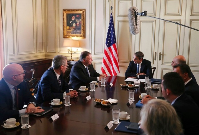 U.S. Secretary of State Mike Pompeo, centre left, speaks to Greek Prime Minister Kyriakos Mitsotakis during their meeting at Maximos Mansion in Athens, Saturday, Oct. 5, 2019. Pompeo is visiting southeastern European countries to show support for new NATO members in the region. (Costas Baltas/Pool via AP2