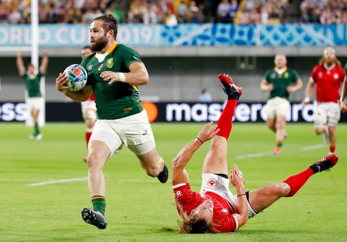 South Africa's Cobus Reinach runs in to score a try during the Rugby World Cup Pool B game at Kobe Misaki Stadium between South Africa and Canada in Kobe, Japan, Tuesday, Oct. 8, 2019. (Kyodo News via AP)