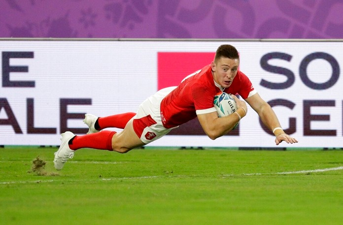 Wales' Josh Adams crosses for a try during the Rugby World Cup Pool D game at Oita Stadium between Wales and Fiji in Oita, Japan, Wednesday, Oct. 9, 2019. (AP Photo/Aaron Favila)