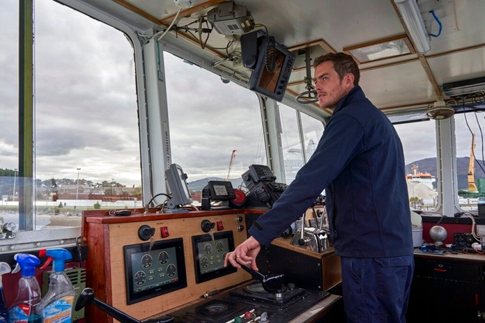 Shane Horner pilots a small ferry across the calm waters of Carlingford Lough connecting Northern Ireland with the Republic of Ireland, Wednesday, Oct. 2, 2019. The ferry service has run for over two years, as another sign that the border is all but invisible but if the U.K. leaves the European Union on Oct. 31 without a Brexit divorce deal, this local boat could find itself plying an international border. (AP Photo/David Keyton)