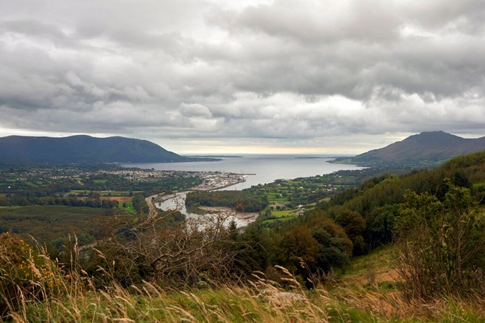 Warrenpoint village in the UK, Northern Ireland nestles on the banks of Carlingford Lough with its ferry that connects Northern Ireland, left of photo, with the Republic of Ireland, right. The island of Ireland border issue has been the most intractable issue in the Brexit negotiations. (AP Photo/David Keyton)