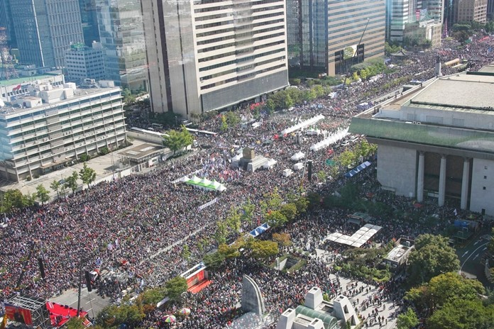 Thousands of demonstrators gather during a rally in Seoul, South Korea, Wednesday, Oct. 9, 2019, for the second consecutive week to call for the ouster of President Moon Jae-in's hand-picked justice minister, whose family is at the center of an investigation into allegations of financial crimes and academic favors. (Kim Seung-doo/Yonhap via AP)