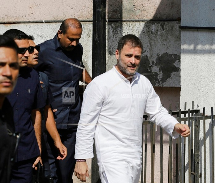 India's opposition Congress party leader Rahul Gandhi arrives at a court in Ahmadabad, India, Friday, Oct. 11, 2019, in connection with two defamation suits filed against him. (AP Photo/Ajit Solanki)
