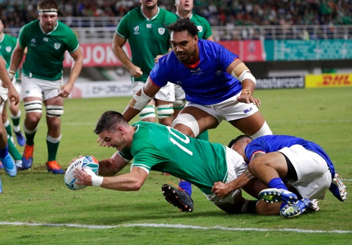 Ireland's Johnny Sexton reaches out to score a try during the Rugby World Cup Pool A game at Fukuoka Hakatanomori Stadium between Ireland and Samoa, in Fukuoka, Japan, Saturday, Oct. 12, 2019. (AP Photo/Aaron Favila)