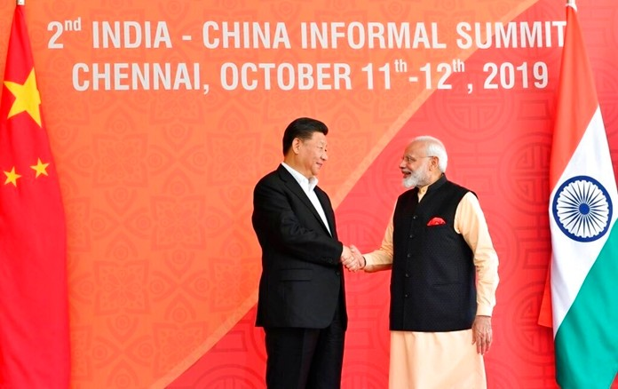 In this handout photo provided by the Indian Prime Minister's Office, Chinese President Xi Jinping and Indian Prime Minister Narendra Modi shake hands in Mamallapuram, India. (Indian Prime Minister's Office via AP)