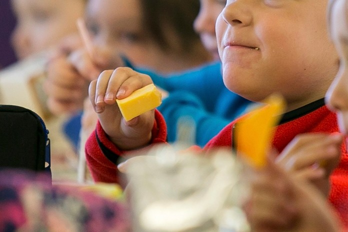 Kids eat lunch at an elementary school in Paducah, Ky. It is far easier to avoid gaining weight than to lose it, so getting kids to eat well and exercise is crucial. But how to do that effectively is extremely difficult — and sensitive. (Ellen O'Nan/The Paducah Sun via AP)
