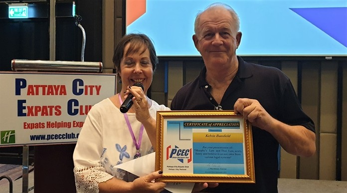 "MC Judith Edmonds presents Kelvin Bamfield with the PCEC's Certificate of Appreciation for his interesting and sometimes humorous presentation on ""Murphy's Law and Thai Law""."