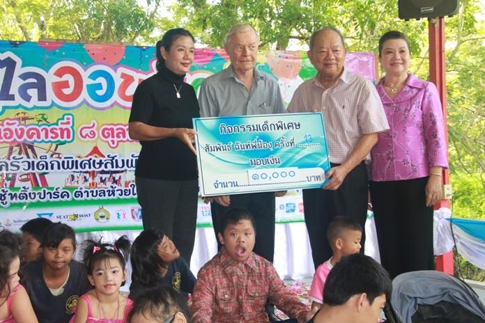 Mr. Wolfgang donates 10,000 baht.