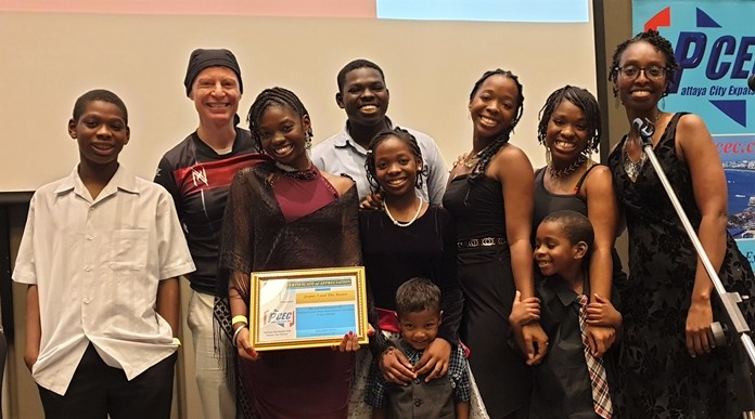 MC Ren Lexander presented the Simons with the PCEC's Certificate of Appreciation for their entertaining performance and history. From left to right, Omega, Ren, Shekinah, Michael, Genesis, Shalom, Adoration, and Tirina (their mother). In the very front are Chris and Gowcohn who also joined their siblings in providing the entertainment.