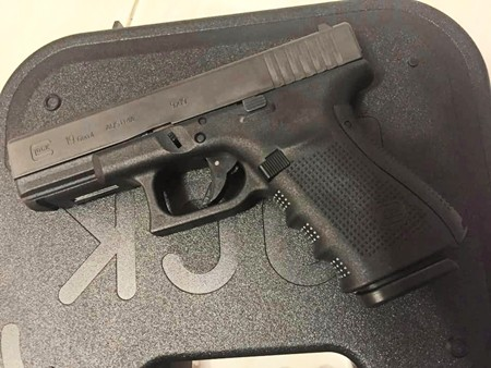 During his arrest, police found a 9 mm semiautomatic.