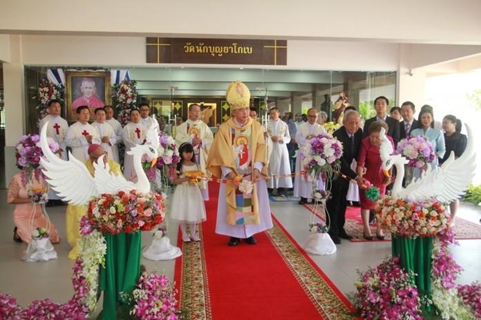 Bishop Silvio Siripong Charatsri, the Bishop of Chantaburi, cuts the ribbon at the grand opening of the new St. James Catholic Church at Maryvit School in Bowin, Sriracha.