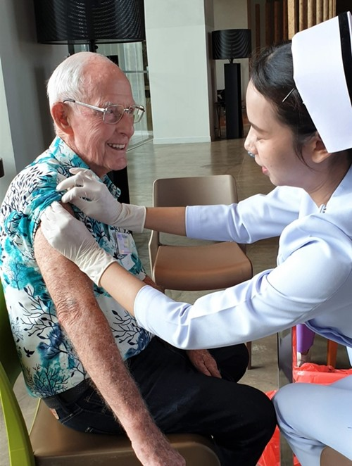 PCEC Vice Chairman Richard Smith even has a smile on his face while being jabbed with the needle as he takes the opportunity to get this year's flu vaccination before the start of the regular Sunday morning meeting.
