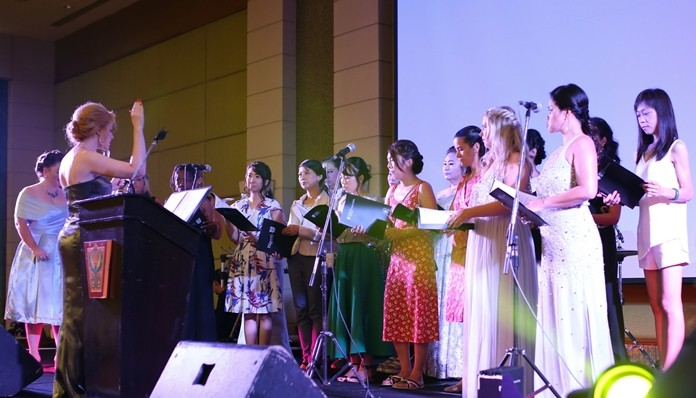 Rhian Curtis conducts the school choir, enchanting the guests with their beautiful rendition of the classics.