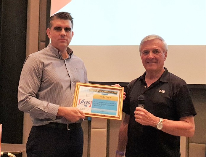 MC Ron Hunter presents Mike Doyle with the PCEC's Certificate of Appreciation for his interesting and enlightening presentation about legal problems that can be encountered in Thailand related to estate planning, terminating an employee, or buying condominiums off plan.