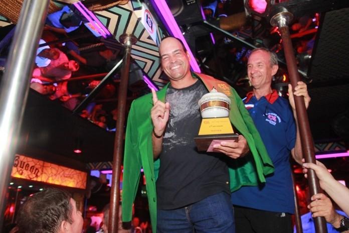 Mr. Lewis (Woody) Underwood presents the coveted TQ Masters Green Jacket to worthy winner Victor Diaz.