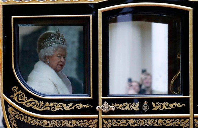 Britain's Queen Elizabeth II travels in a carriage to parliament for the official State Opening of Parliament in London, Monday, Oct. 14, 2019. (AP Photo/Frank Augstein)