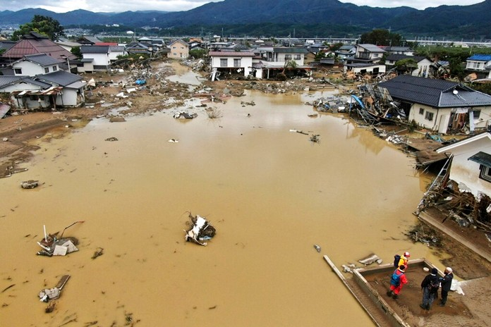 A residential area is flooded after an embankment of the Chikuma River broke due to Typhoon Hagibis, in Nagano, central Japan. (Kyodo News via AP)