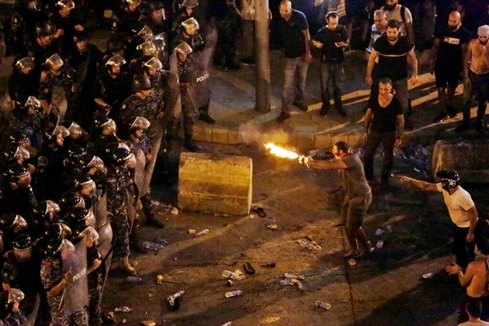 Lebanon erupted in protests Thursday over the government's plans to impose new taxes amid a severe economic crisis, taking their anger on politicians they accuse of widespread corruption and decades of mismanagement. (AP Photo/Hassan Ammar)