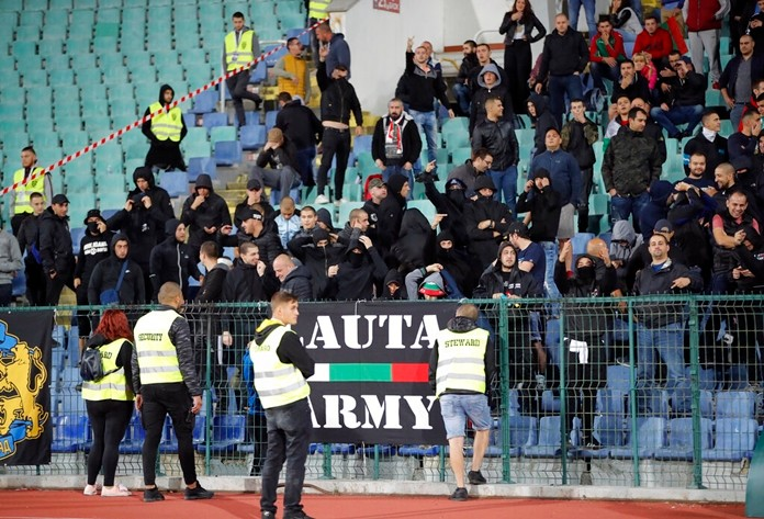 Bulgarian fans gesture as they stand in the stadium to watch the Euro 2020 group A qualifying soccer match between Bulgaria and England, at the Vasil Levski national stadium, in Sofia, Bulgaria, Monday, Oct. 14, 2019. (AP Photo/Vadim Ghirda)