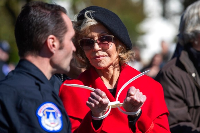 Actress Jane Fonda gestures after being arrested during a rally on Capitol Hill in Washington, Friday, Oct. 18, 2019. A half-century after throwing her attention-getting celebrity status into Vietnam War protests, 81-year-old Jane Fonda is now doing the same in a U.S. climate movement where the average age is 18. (AP Photo/Manuel Balce Ceneta)