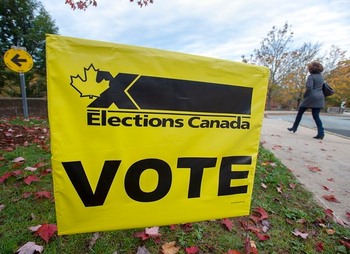 A voter heads to cast a vote in Canada's federal election at the Fairbanks Interpretation Centre in Dartmouth, Nova Scotia, Monday, Oct. 21, 2019. (Andrew Vaughan/The Canadian Press via AP)