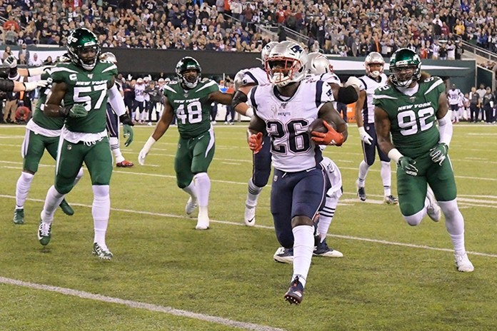 New England Patriots running back Sony Michel (26) gets away from New York Jets' C.J. Mosley (57) and Leonard Williams (92) for a touchdown during the first half of an NFL football game Monday, Oct. 21, in East Rutherford, N.J. (AP Photo/Bill Kostroun)
