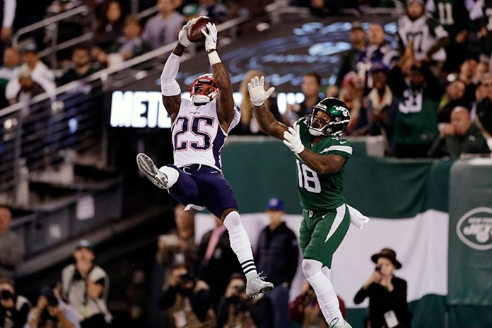 New England Patriots' Terrence Brooks (25) intercepts a pass to New York Jets' Demaryius Thomas (18). (AP Photo/Adam Hunger)