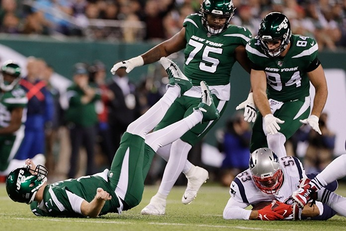 New England Patriots middle linebacker Kyle Van Noy (53) recovers the ball fumbled by New York Jets quarterback Sam Darnold, left, after Darnold was sacked during the first half. (AP Photo/Adam Hunger)