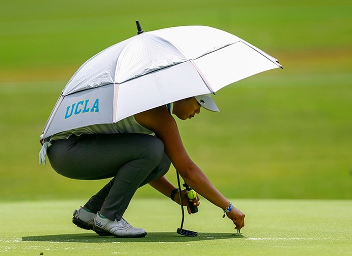 In this Thursday, May 31, 2018, file photo, Patty Tavatanakit, of Thailand, fixes a divot on the 18th green during the first round of the U.S. Women's Open golf tournament, in Shoal Creek, Ala. Tavatanakit has secured her LPGA Tour card. (AP Photo/Butch Dill, File)