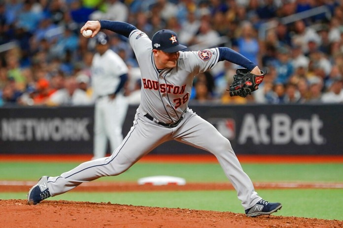Houston Astros' Joe Smith pitches to a Tampa Bay Rays batter during the seventh inning of Game 4 of a baseball American League Division Series, Tuesday, Oct. 8, 2019, in St. Petersburg, Fla. (AP Photo/Scott Audette)