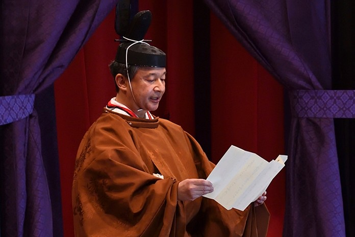 Emperor Naruhito delivers his speech during the enthronement ceremony where he officially proclaims his ascension to the Chrysanthemum Throne at the Imperial Palace in Tokyo on Tuesday, Oct. 22, 2019. (Kazuhiro Nogi/Pool Photo via AP)