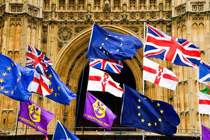 Various flags flutter in the wind outside the houses of Parliament in London. There are just 9 days until the U.K. is due to leave the European bloc on Oct. 31. (AP Photo/Alberto Pezzali)
